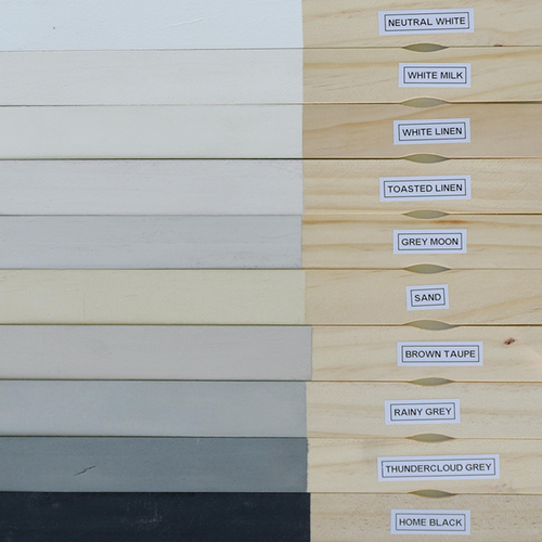 Colour samples painted on wood and photographed in daylight