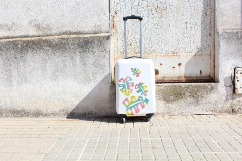 spray painted suitcase using reverse templates