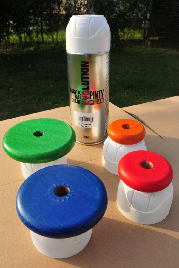 spray painting a stackable toy tower