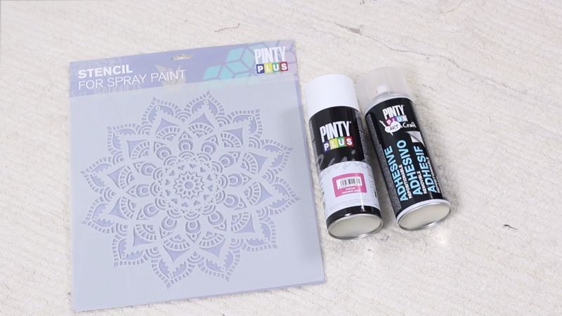 using a stencil with spray paints