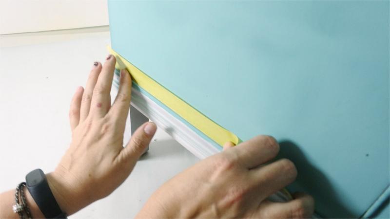 Using masking tape to prepare areas before spray painting