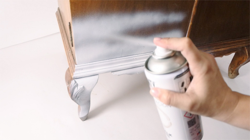 Spraying wooden furniture with chalk paint