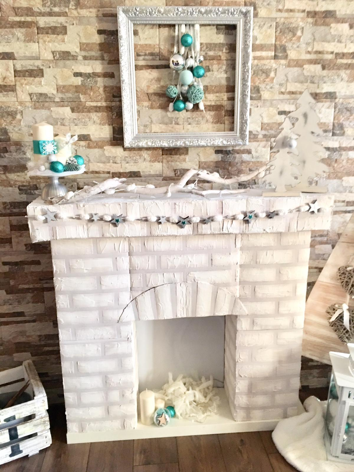 the finished artificial christmas fireplace