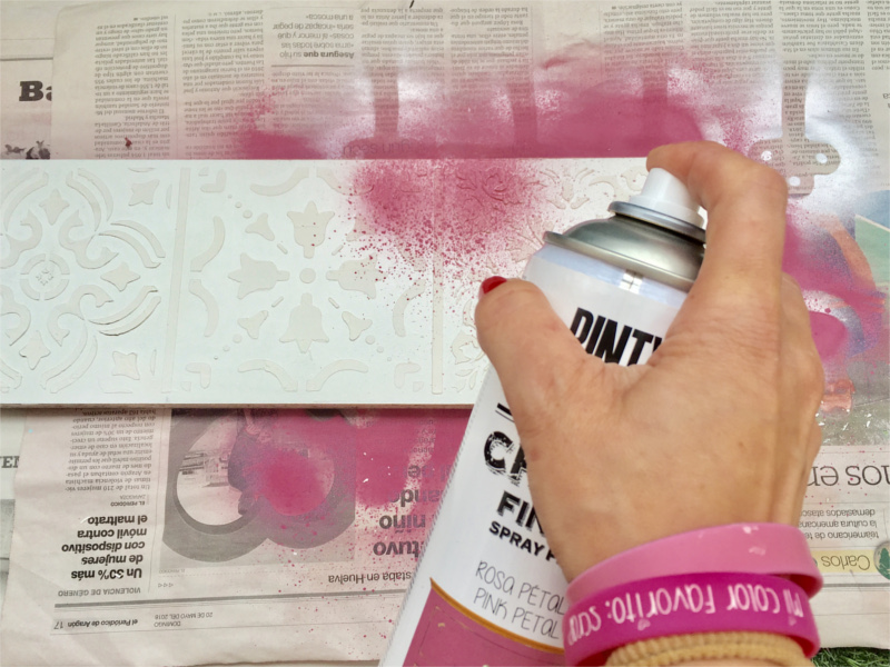 using spray chalk paint with stencils