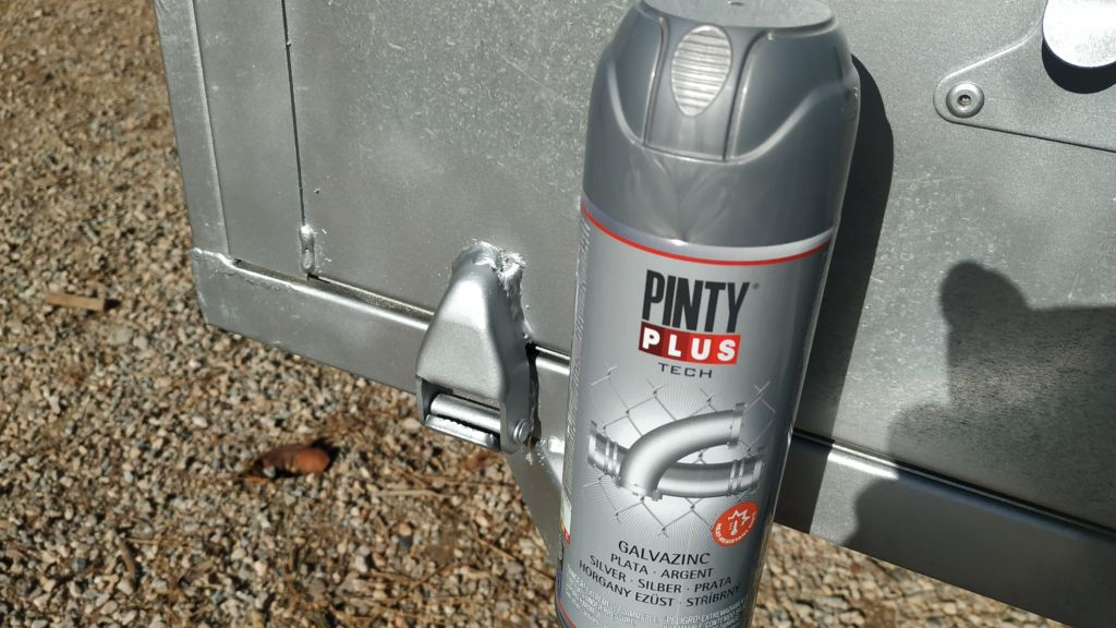 spray painting a galvanised metal trailer