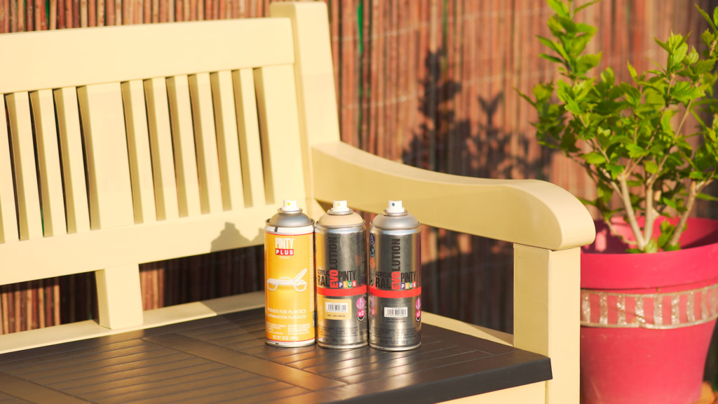 plastic garden bench painted with spray paint